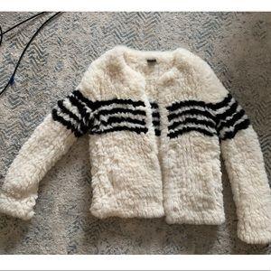 Fur jacket with black stripes